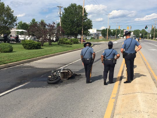 A crash between a motorcycle and a car is investigated