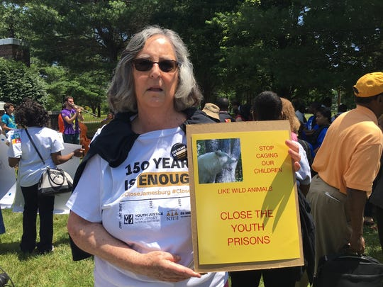 Susan MacDonnell of Monroe attends a rally to close the New Jersey Training School for Boys in Monroe.