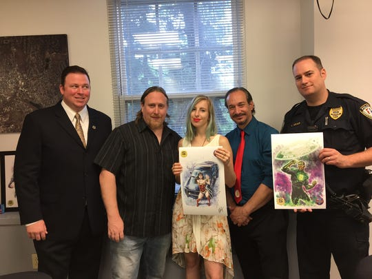 From left, Morristown P.B.A. President Eric Petr, Garden State Comic Fest co-promoter Dave O'Hare, artist Bella Rachlin, Garden State Comic Fest owner and promoter Sal Zurzolo, and Morristown Sgt. Michael Molnar.