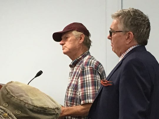 Mike McKeel, left, and attorney Bruce Munson at a plan
