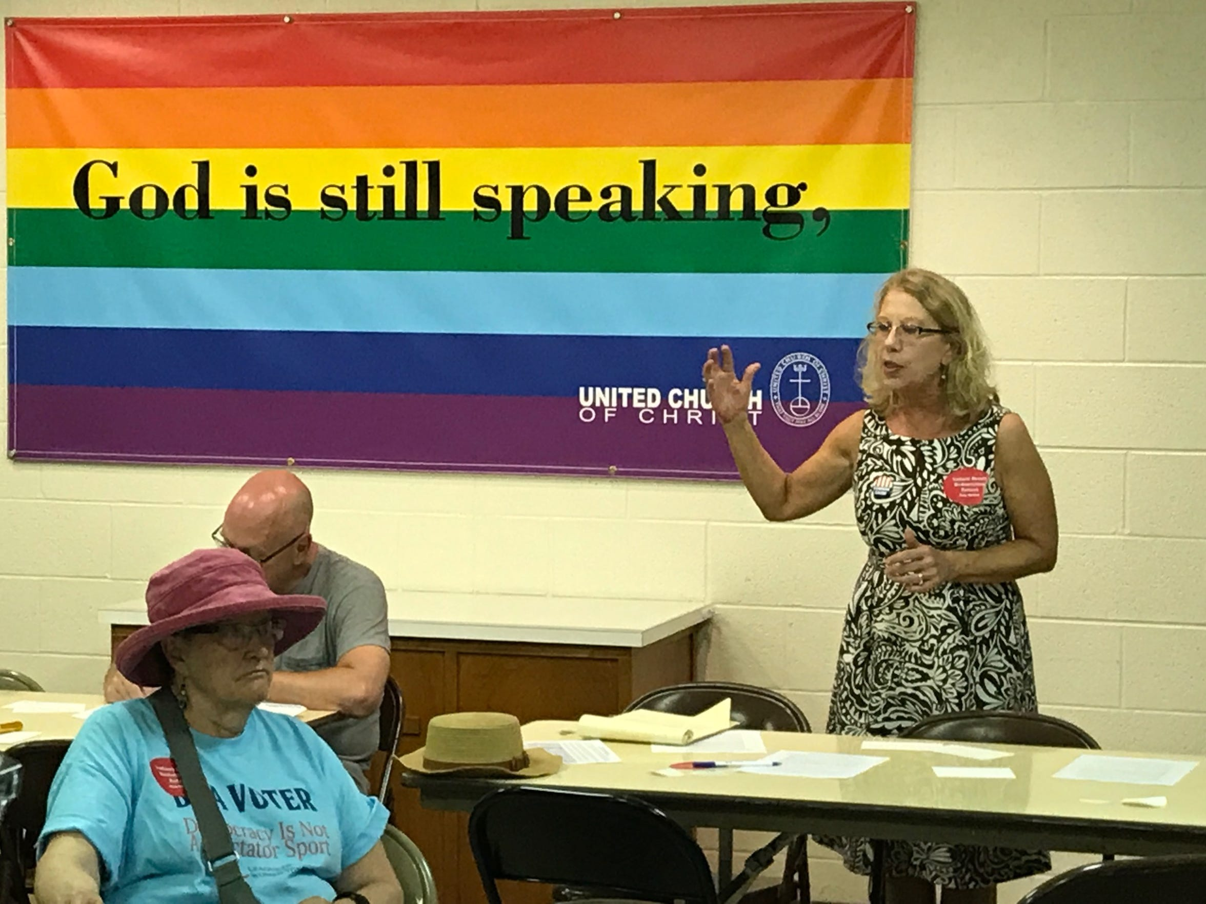 Julia Vaughn, policy director for Indiana Common Cause, speaks at Gerrymander Meander, an event put on by the League of Women Voters on Monday night. Volunteers walked the Jimtown neighborhood to raise awareness of gerrymandering.