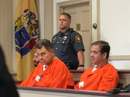 From left and leaning forward on bench is Alesio J. Politi of Toms River, and on right in orange jumpsuit is Michael Kiszka of East Hanover, in Superior Court, Morristown, on July 10, 2017.
