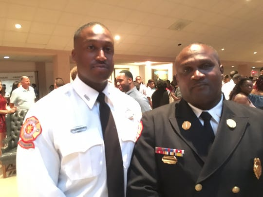 Micheal Jamison Jr. (left) is joining his father Lt. Micheal Jamison Sr. (right) in the Memphis Fire Department.
