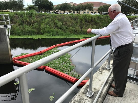 Indian River County Commissioner Peter O'Bryan looks at the structure built on the Main Relief Canal in Vero Beach to clean water before it reaches the Indian River Lagoon.
