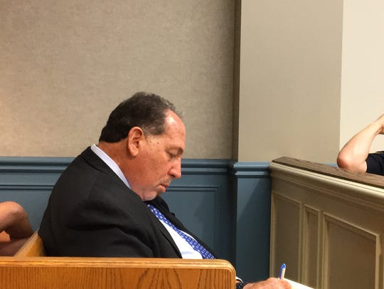 Morris County Prosecutor Fredric M. Knapp takes notes