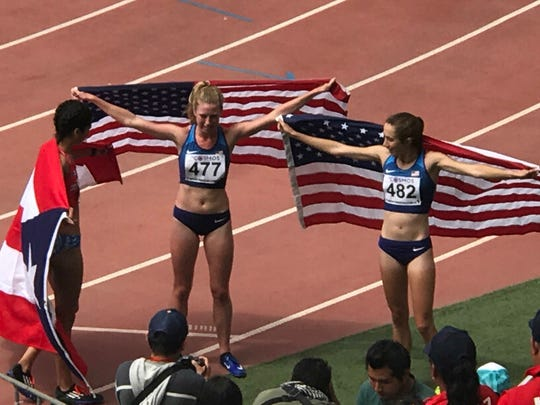 Alex Harris (r) with American flag after third-place
