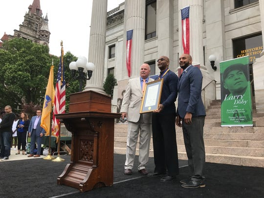 Larry Doby Jr., (center), flanked by freeholders Terry Duffy ( l ) and TJ Best ( r ).