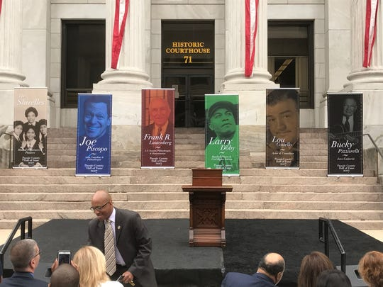 The banners of the six inductees into  the new Passaic County Hall of Fame are lined up on the courthouse steps.