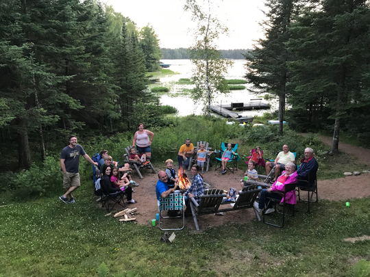 Columnist Susan Manzke's family gathers around the fire during their latest summer vacation.