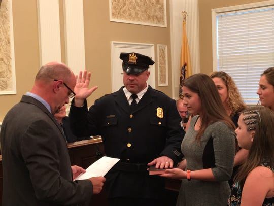 Anthony Scinto is sworn in July 25, 2017 to the position
