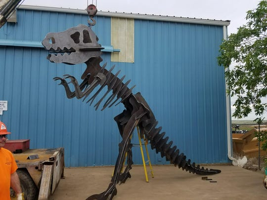 Anderson Steel is donating a steel statue of a T-Rex