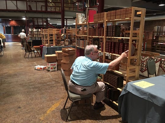 Michael Slicker of Lighthouse Books in St. Pete, setting up booth in Franklin, Tennessee.