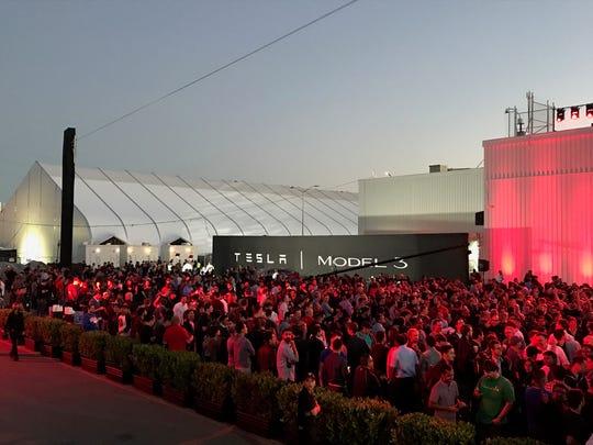 Hundreds gather outside of Tesla's Fremont, Calif.,