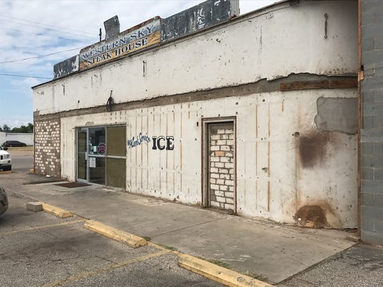 Western Sky Steakhouse, 2024 N. Chadbourne St., is undergoing an exterior remodeling that revealed interesting frescoes from a bygone era.
