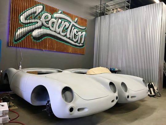 Two fiberglass bodies await a paint job at the garage
