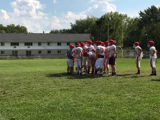 Pacelli players huddle together before splitting off