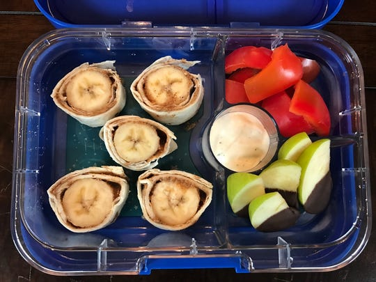 Combine nut butter, banana and a tortilla for a kid-friendly packed lunch idea.