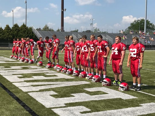 Pacelli football players line up for the National Anthem prior to the opening kickoff against Dodgeland at Community Stadium in Goerke Park on Saturday.