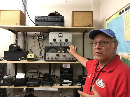 Ed Efchak of the Fair Lawn Amateur Radio Club showing off some equipment. The club took part in an experiment related to the eclipse on Monday.