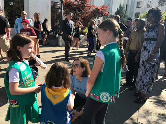 Gov. Kate Brown talks with a group of girl scouts at the Oregon State Capitol, Aug. 21, 2017.