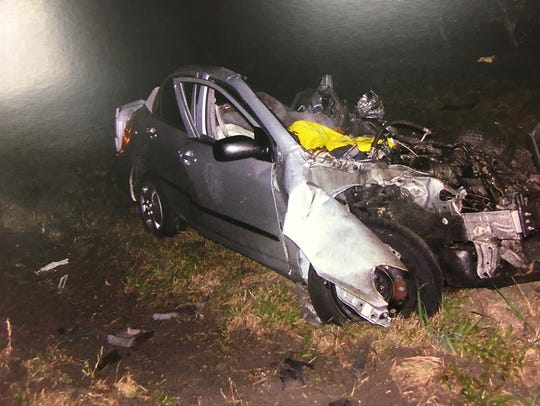 A crash scene photograph of the Toyota in which two