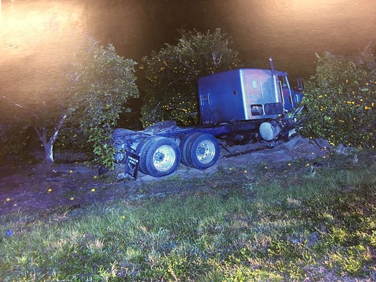 A crash scene photograph shows the semi that hit two