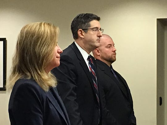 From left: Middlesex County Assistant Prosecutor Christine D'Elia, attorney Charles Sciarra and Carteret Police Officer Joseph Reiman appear in court before Midddlesex County Superior Court Judge Michael Toto for a hearing on Thursday morning.