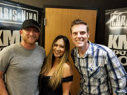 """Country artist Cole Swindell (left) was the special mystery guest at KMLE 107.9's """"8 Man Jam,"""" and appeared backstage with KMLE's morning personalities Nina D and Chris Matthews."""