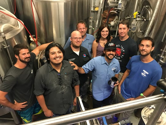 Bobby Harms (from left), Edd Adams, Richard Mathews, Varian Criser, Jessica Dobbs, Sean Sutherland and Cory Mathews gathered at Lorelei Brewing Co. Wednesday Sept. 6 to brew a beer with proceeds to help with Hurricane Harvey relief efforts.