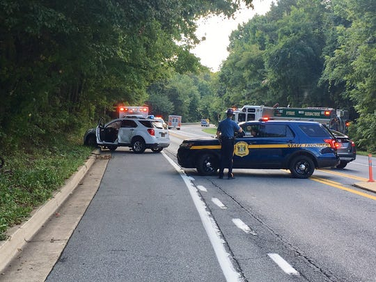 The Delaware State Police Collision Reconstruction Unit investigates a fatal motor vehicle crash on New Linden Hill Road in Pike Creek on Thursday.