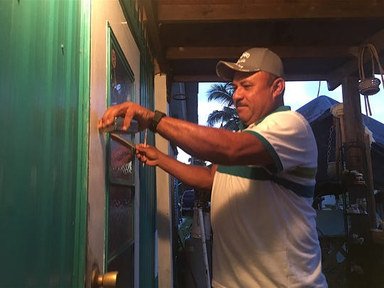 Resident at the Palm on Pine Island prepares for the impact of Hurricane Irma.