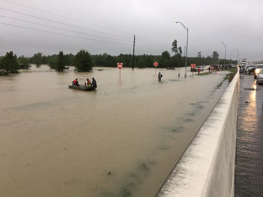 Boats launch rescue efforts from flooded Interstates