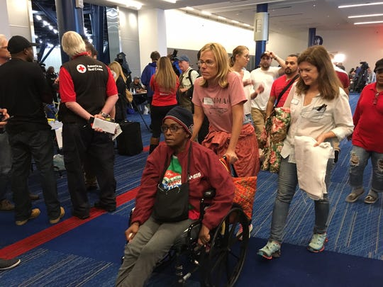 Evacuees pour into the George R. Brown Convention Center