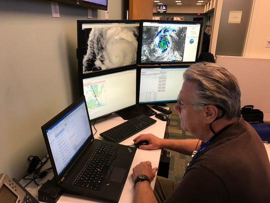 Florida Power & Light Co. meteorologist Tim Drum monitors