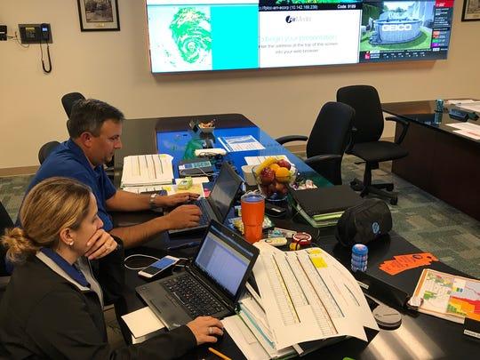 Ed Devarona, senior director of emergency preparedness, and Iliana Rentz, emergency preparedness manager, make power restoration plans during Hurricane Irma. Devarona and Rentz were stationed in Florida Power & Light Co.'s Riviera Beach command center.