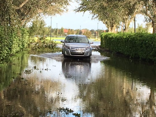 A road flooded in the Hampton Park subdivision in Gateway