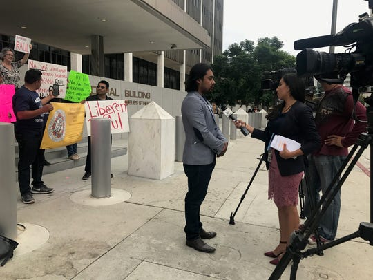 Arcenio J. Lopez, MICOP executive director, speaks to television reporters about the nonprofit's board member Luis Lopez-Diaz. The nonprofit group Mixteco/Indigena Community Organizing Project advocates for Ventura County's Mexican indigenous population.