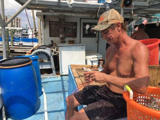 Chances R III crew member Shaun Olschewski makes up leaders Thursday on San Carlos Island for an upcoming offshore fishing trip after Hurricane Irma. Because of the storm, it's been almost a month since Olschewski has been able to work.