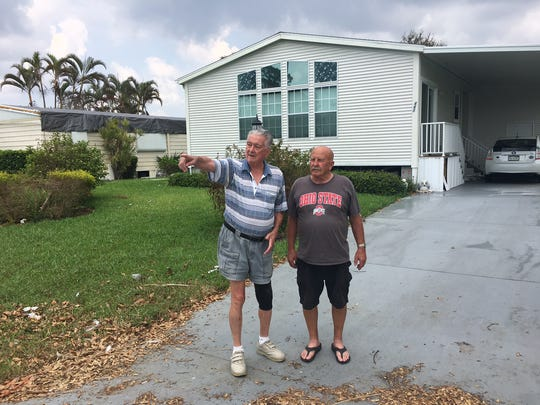 Allen Jost, left, and John Myers, revisit the spot in Riviera Golf Estates where Myers pulled Jost from floodwaters on Sept. 11.