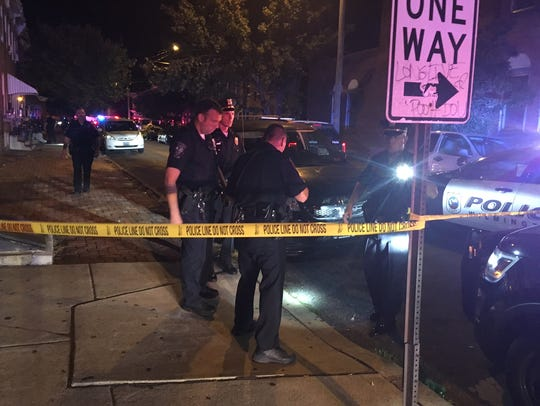 Police investigate the Saturday night shooting which