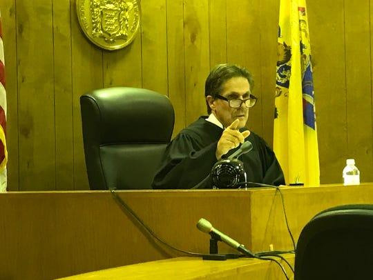 Superior Court Judge Ernest M. Caposela issues his