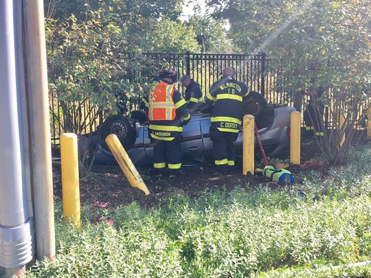 Emergency crews respond to a crash at Seventh Street and Woodlawn Avenue in Wilmington on Friday, Sept. 29, 2017