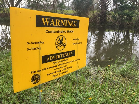 Brevard County officials have posted warning signs at Anchor Drive canal, where the county has discharged some 13 million gallons of diluted wastewater, to avoid sewage backups after Hurricane Irma.
