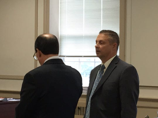 On left, attorney Christopher Deininger with retired Parsippany Police Capt. James Carifi in Superior Court, Morristown, Oct. 16, 2017.