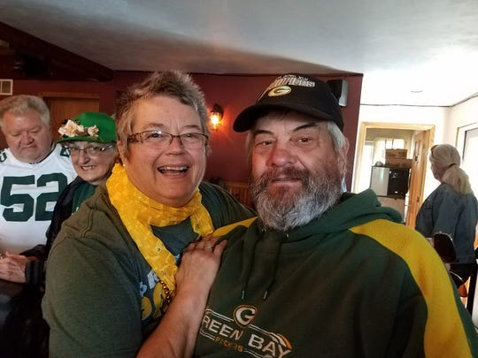 Becky Gosser, left, and Ralph Bochek, Gosser's significant other, at a Green Bay Packer party early in October 2017.
