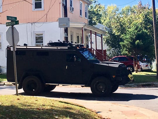 An armored vehicle sits at Cunard and Munson streets