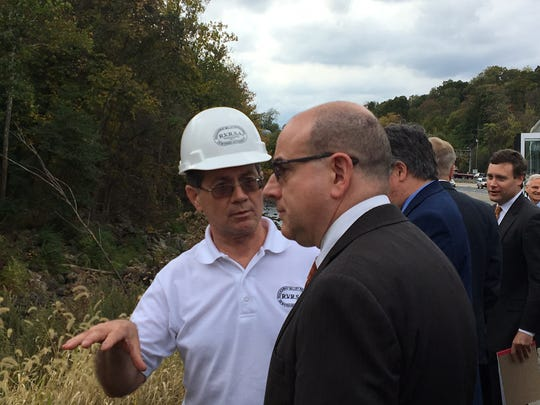 As research for a civil case, Superior Court Assignment Judge Stuart Minkowitz is shown the area off Route 287 where Hurricane Irene in 2011 damaged a sewage line. With Minkowitz is Rockaway Valley Regional Sewerage Authority Plant Manager Mario Bonaccorso.