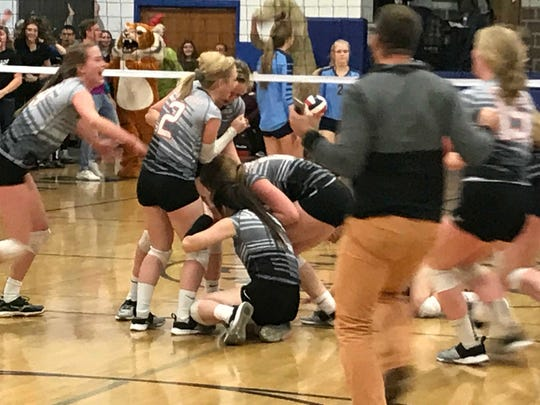 Stratford volleyball players celebrate after the final point in a 23-25, 25-14, 17-25, 25-18, 15-9 win over Saint Mary Catholic in a Division 3 sectional championship match Saturday night.