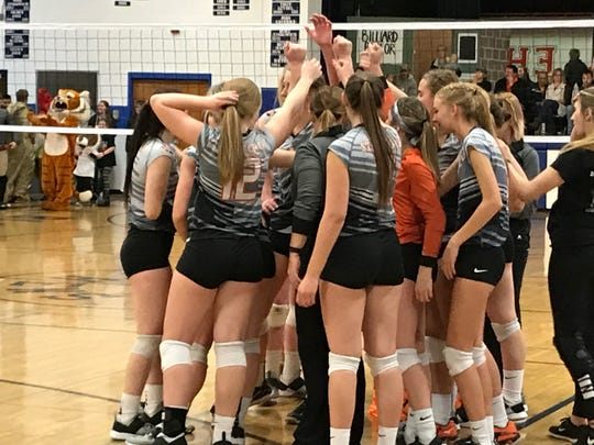 Stratford volleyball players huddle around coach Brooke Kafka during a timeout in the fifth set of their Division 3 sectional championship match with Saint Mary Catholic at Athens High School on Saturday night.
