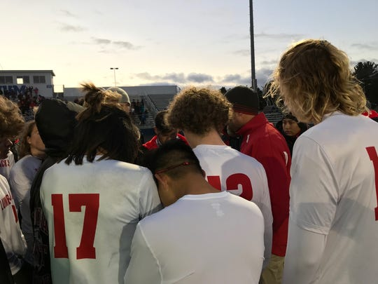 Wausau East boys soccer players receive some final words of solace from head coach Jeff Sorenson after a 3-0 setback to New Richmond in a Division 2 sectional championship match Saturday at Jay Stadium in Merrill.
